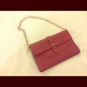 Small Furla clutch with chain